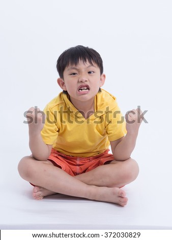 asian boy angry handful frustrated shouting unhappy frown - stock photo