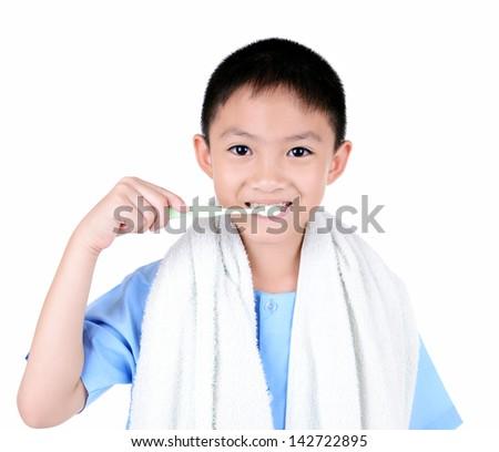 Asian boy brushing teeth, isolated on white background - stock photo