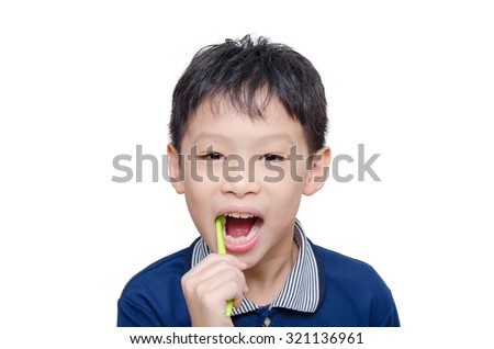 Asian boy cleansing teeth by toothbrush over white