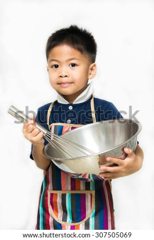 Asian boy cooking - stock photo