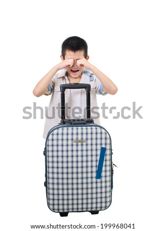 Asian boy crying with suitcase. Isolation on the white - stock photo