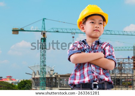 asian boy engineer concept,on construction background - stock photo