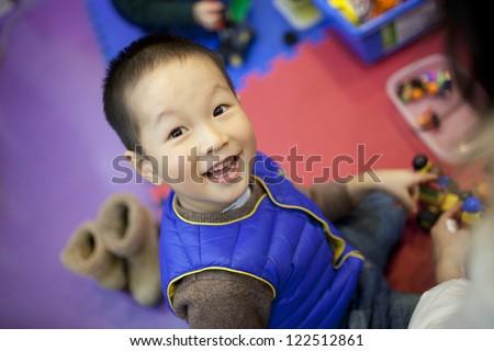 asian boy enjoying the preschool class in classroom - stock photo