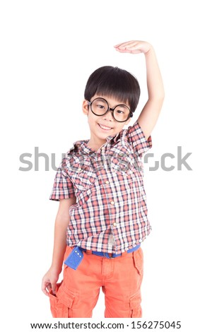 asian boy growing tall and measuring himself on white background - stock photo