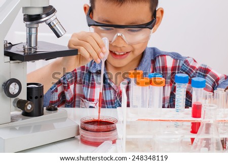 asian boy in science laboratory