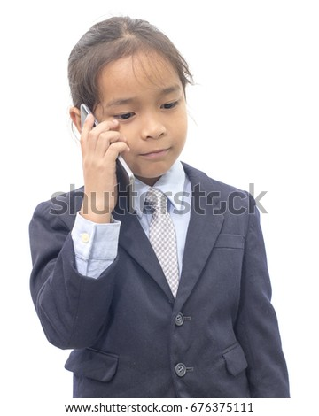 Asian boy in suit talking on mobile phone over white background