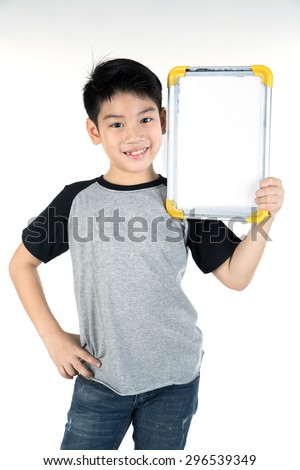 Asian boy is little smile with blank white board and looking camera on white background - stock photo