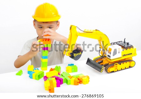 asian boy learning from a toy, little engineer concept - stock photo
