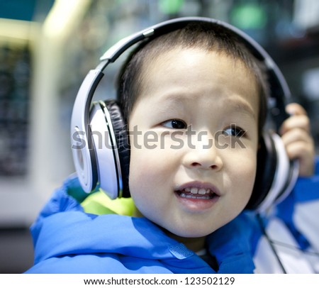 asian boy listening the music at home