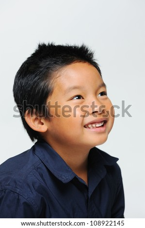Asian boy looking up and smiling