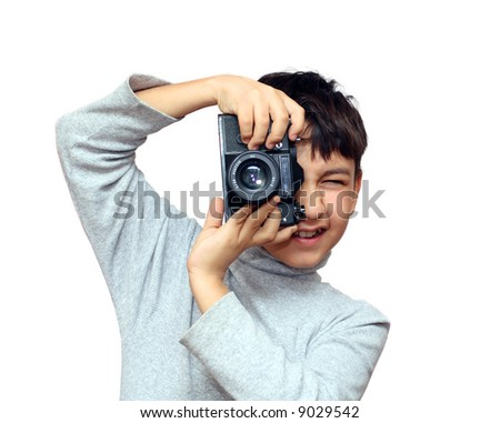 asian boy photographing vertical with black slr camera isolated on white - stock photo