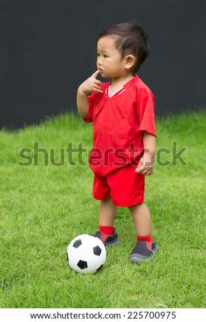 asian boy play football - stock photo