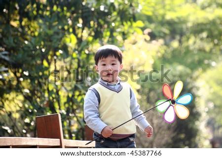 asian boy playing at garden - stock photo