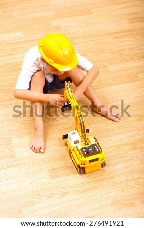 asian boy playing backhoe toy, little engineer concept - stock photo