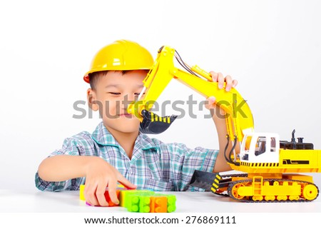 asian boy playing toy, little engineer concept - stock photo