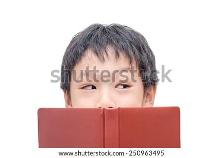 Asian boy reading a book on a white background - stock photo