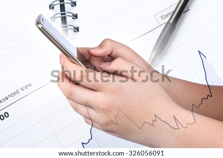 Asian boy's hand holding and touch on Smart phone with blank screen on business background, Social Network, financial, investment