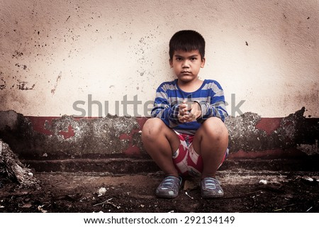 asian boy sad alone sitting with white bear near old wall cement,vintage tone