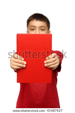asian boy showing big red book isolated on white - stock photo