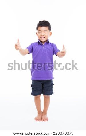Asian boy shwoing thumb isolated on white background.  - stock photo