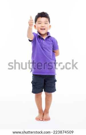 Asian boy shwoing thumb isolated on white background.  - stock photo