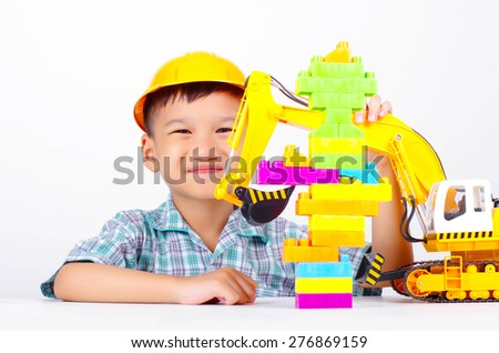 asian boy smile and happy with toy, little engineer concept - stock photo