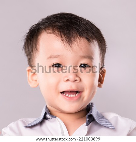 Asian boy smiling close up of face - stock photo