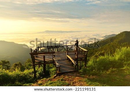 Asian boy taking a photo on the scenic area on the top of mountains. Doi Ang Khang. Chiang Mai. Thailand - stock photo