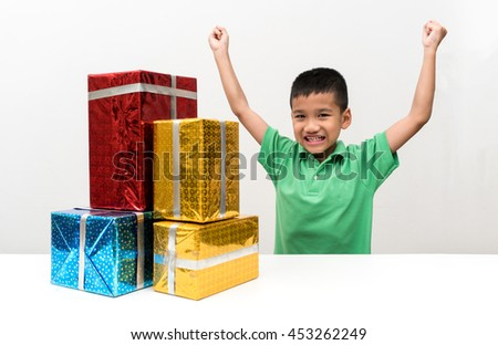 asian boy very happy with birthday surprise gift box - stock photo