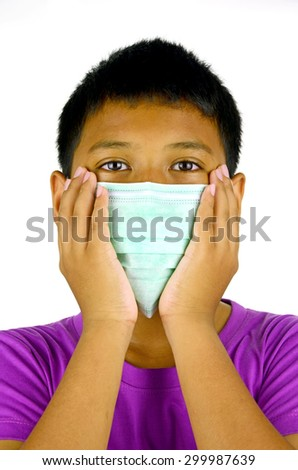 Asian Boy Wearing Face Mask for Protecting airborn Illness. - stock photo