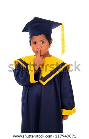 asian boy wearing his graduation cap and gown in silent action isolated on white