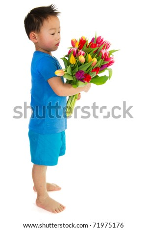 Asian boy with a colorful bouquet tulips