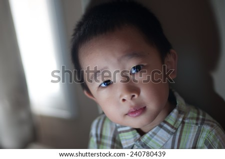 asian boy with available light