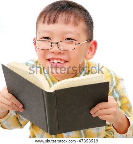 asian boy with glasses holding a book - stock photo