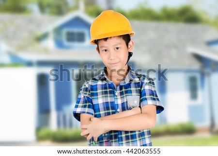 Asian boy with Group of Solar panel system ,turbine and sunny blue sky background - stock photo