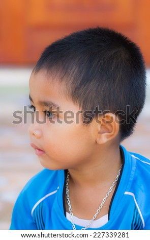 Asian boy with the happy face. - stock photo