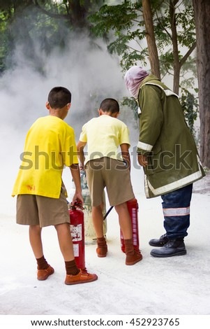 Asian boys are trained firefighters . - stock photo