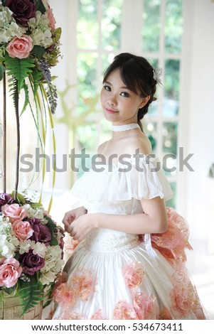 Asian Bride in white dress indoor room