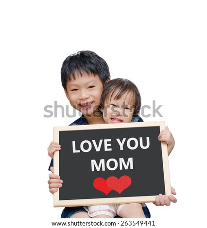 Asian brother ans sister holding chalkboard with Love you mom over white background - stock photo