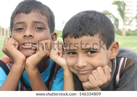 Asian brothers looking at camera - stock photo