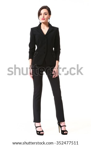 asian brunette skinny fashion model in black trousers and jacket suit full body portrait isolated on white - stock photo