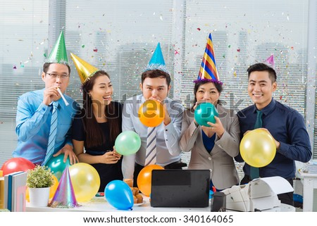 Asian business colleagues having celebration in the office - stock photo