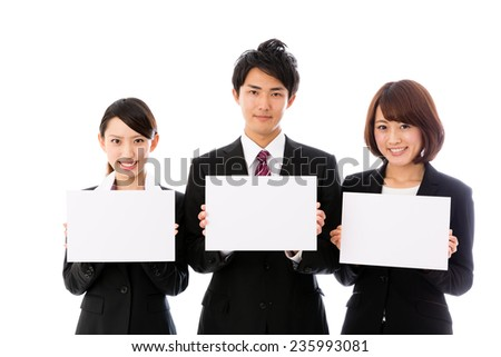 asian business group holding a blank whiteboard - stock photo