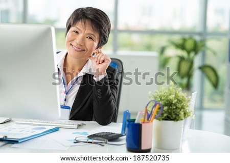 Asian business lady at work - stock photo