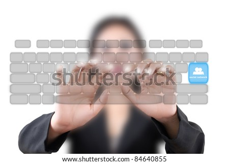 Asian business lady pushing transparent keyboard on the whiteboard. - stock photo