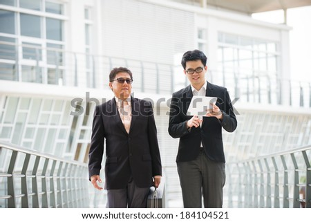 asian business male chatting on tablet