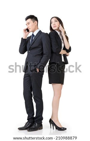 Asian business man and woman take a call, full length portrait isolated on white background. - stock photo