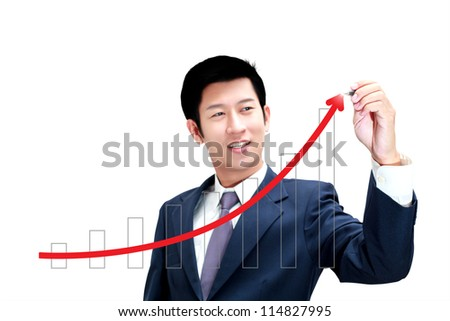 Asian business man drawing a graph of his business growth