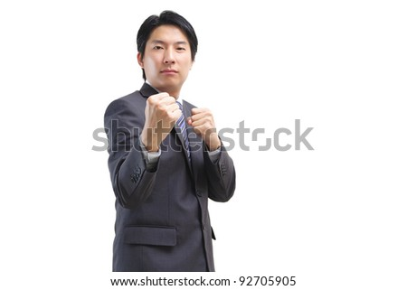 Asian business man fight isolated on white - stock photo