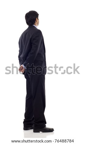 Asian business man from the back - looking at something over a white background - stock photo